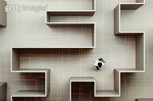 Businesswoman walking in maze - gettyimageskorea