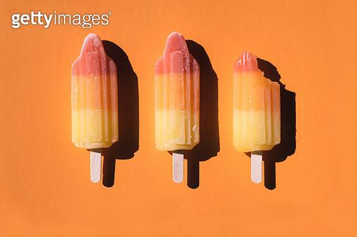 Directly above shot of sorbets arranged on orange background - gettyimageskorea