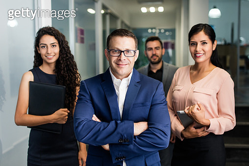 Business executives standing and smiling at camera - gettyimageskorea