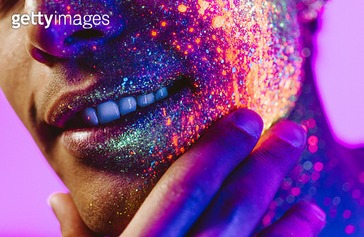 Close-Up Of Portrait Of Man With Fluorescent Makeup On Face - gettyimageskorea