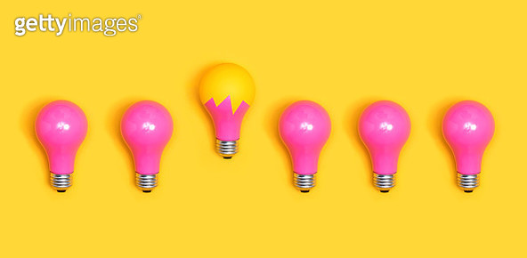 Close-Up Of Pink Light Bulbs Over Yellow Background - gettyimageskorea