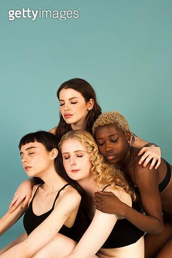Four women hug in the studio - gettyimageskorea