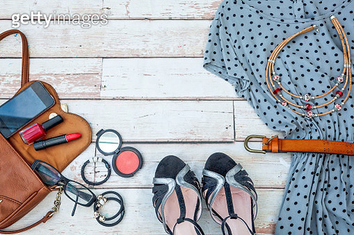 flat lay feminine clothes and accessories collage with black dress, glasses, high heel shoes, purse, watch, mascara, lipstick, - gettyimageskorea