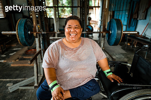 Differently abled Filipino powerlifter smiling - gettyimageskorea