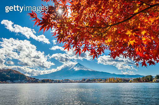 Scenic View Of Lake By Mountains Against Sky During Autumn - gettyimageskorea