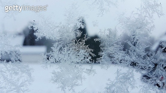 Close-Up Of Snowflakes On Glass Against Sky - gettyimageskorea