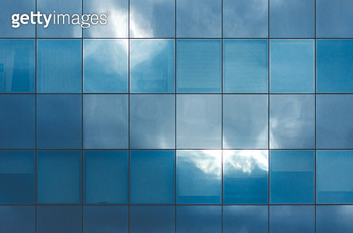 Irregular Clouds And Sky Reflections On Textured Blue Glass - gettyimageskorea