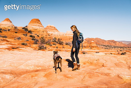 Young woman hiking with dog, Grand Staircase Escalante National Monument - gettyimageskorea