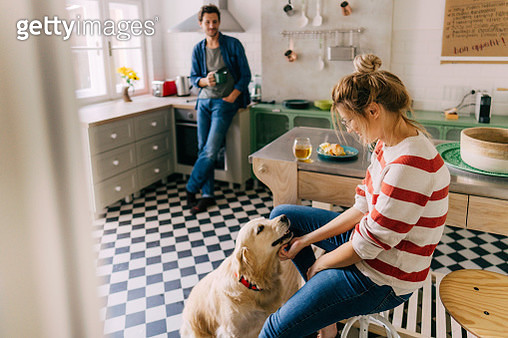 Morning in the kitchen with our dog - gettyimageskorea