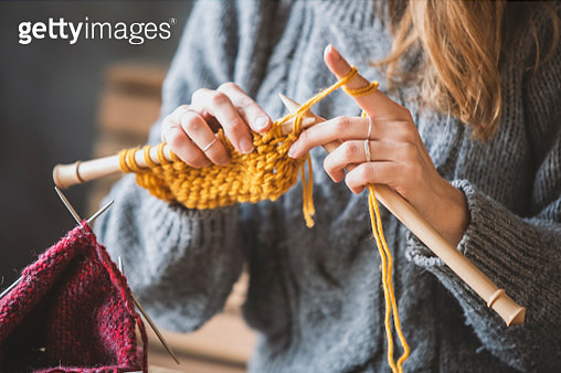Close up on woman's hands knitting - gettyimageskorea