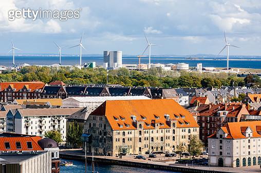 Copenhagen skyline with wind turbines in the background, Denmark - gettyimageskorea