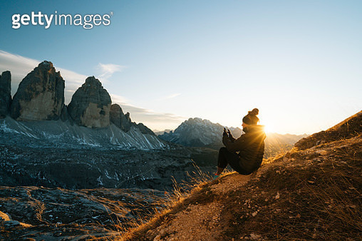 Female hiker looks at view at sunset - gettyimageskorea