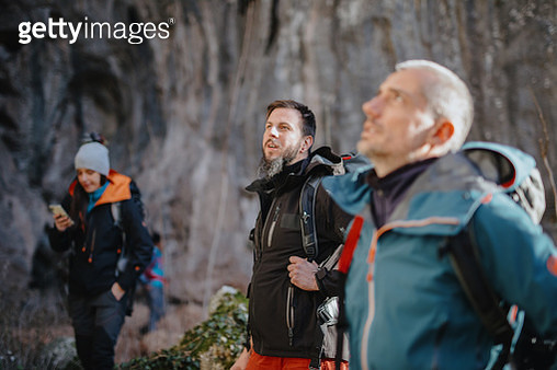 Group of hikers with backpacks enjoying the view in the mountains - gettyimageskorea