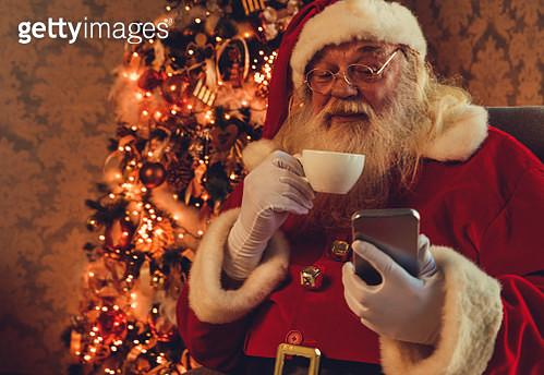 Santa using mobile - gettyimageskorea