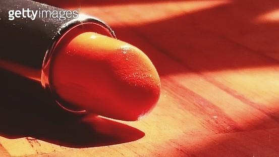 Close-Up Of Orange Lipstick On Table - gettyimageskorea