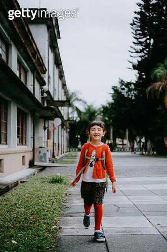 Cute preschool mixed race girl walking on street, Taiwan - gettyimageskorea