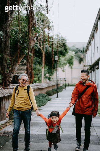 Happy three generation family holding hands and walking on street, Taiwan - gettyimageskorea