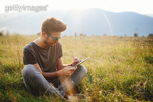 Vintage toned portrait of a young man sitting and relaxing - gettyimageskorea