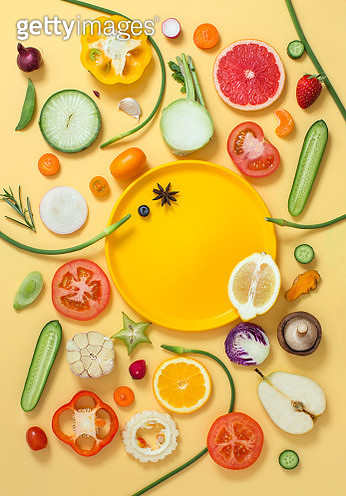 Assorted cross section vegetables and fruits on yellow background. - gettyimageskorea