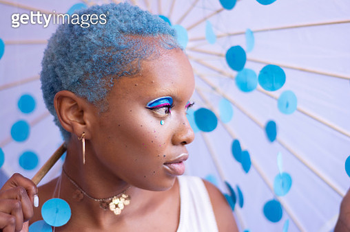 A woman with blue hair - gettyimageskorea