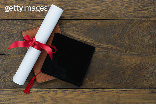 High Angle View Of Degree With Diary And Mortarboard On Table - gettyimageskorea