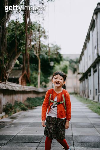 Portrait of cute preschool mixed race girl laughing on street, Taiwan - gettyimageskorea