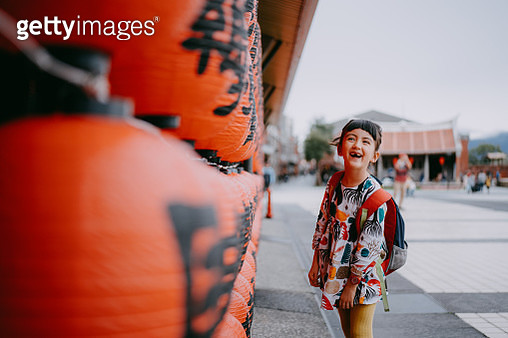 Adorable young mixed race girl laughing on street with red lanterns, Taiwan - gettyimageskorea