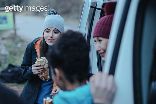 Group of climbers eating during rest from extreme rock climbing - gettyimageskorea
