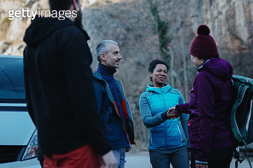 Woman introducing herself to the rest of the climbing group - gettyimageskorea