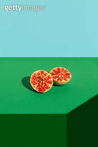 Studio shot of halved pomegranate - gettyimageskorea