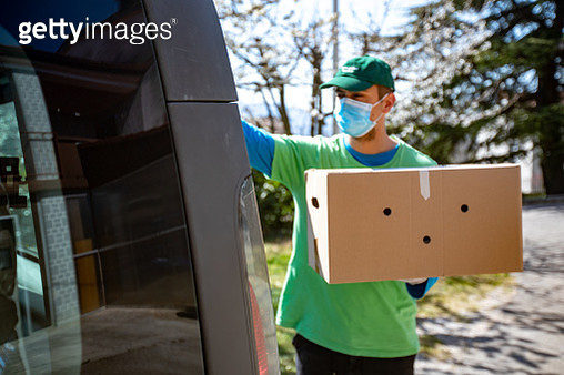 Young Adult Home Delivery Man Working During Coronavirus Pandemic - Stock Photo - gettyimageskorea