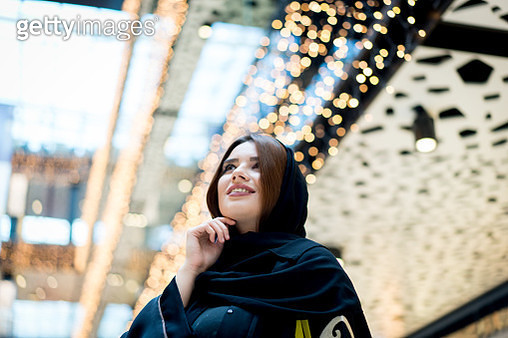 Middle Eastern young woman in shopping mall - gettyimageskorea