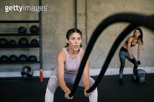 Young woman trains with workout ropes - gettyimageskorea