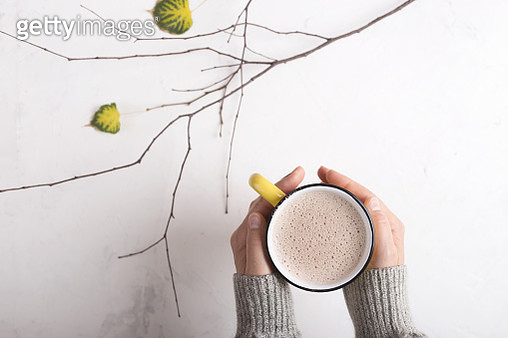 Overhead view of woman holding mug of hot chocolate - gettyimageskorea