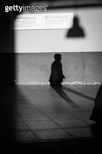 Black And White Image Of A Persons Silhouette On A Wall. - gettyimageskorea