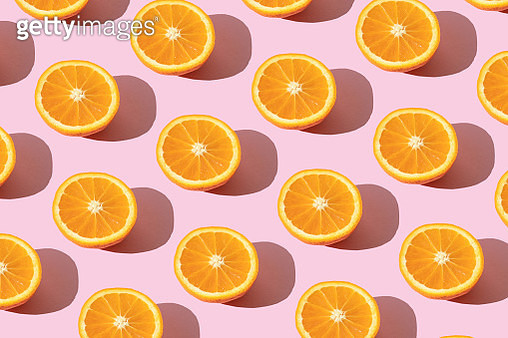 Repeated orange on the pink background - gettyimageskorea