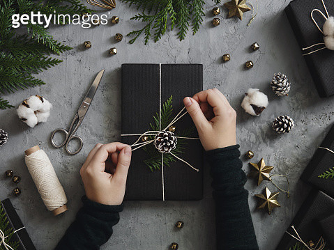 High angle view of woman decorating Christmas presents - gettyimageskorea