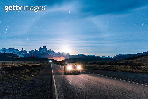 Car driving at night on the road to El Chalten, Patagonia Argentina - gettyimageskorea