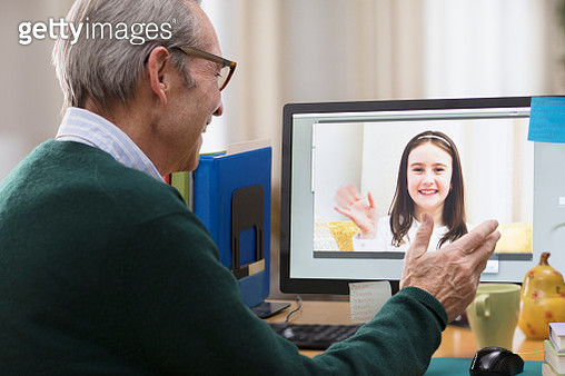 Grandfather video-chatting with granddaughter - gettyimageskorea