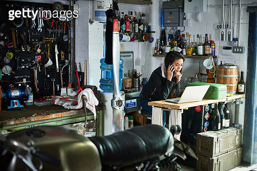 Female owner in motorcycle workshop. - gettyimageskorea