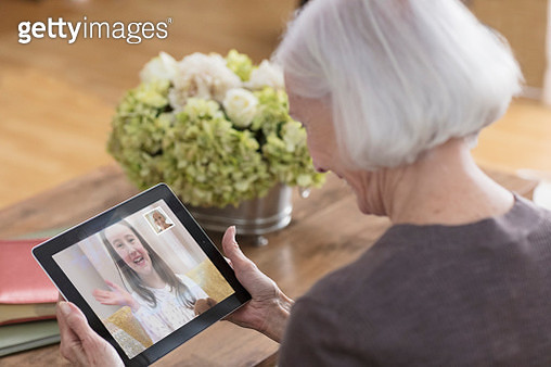 Grandma video-chatting with granddaughter - gettyimageskorea