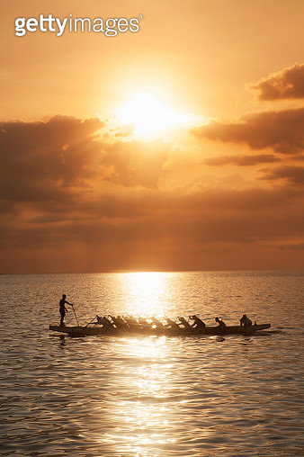 Traditional Philippine boat with rowers - gettyimageskorea