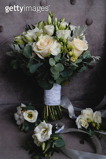 Beautiful white wedding bouquet and boutonnieres for bridesmaids. - gettyimageskorea