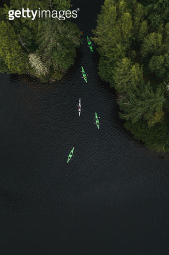 Aerial shot directly above kayakers on a Scottish Loch, Scottish Highlands, United Kingdom - gettyimageskorea