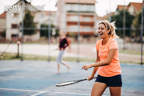 Happy young girls playing tennis - gettyimageskorea