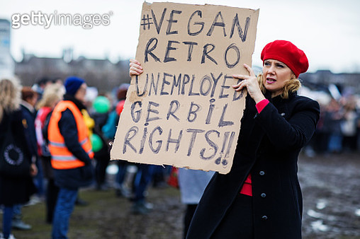 Beautiful blonde middle aged woman at an outdoor protest - gettyimageskorea