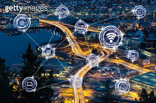 Wireless communication connecting of smart city Internet of Things Technology over Top view express way with traffic light at the Bergen cityscape at the sunset time, Norway, business IOT concept - gettyimageskorea