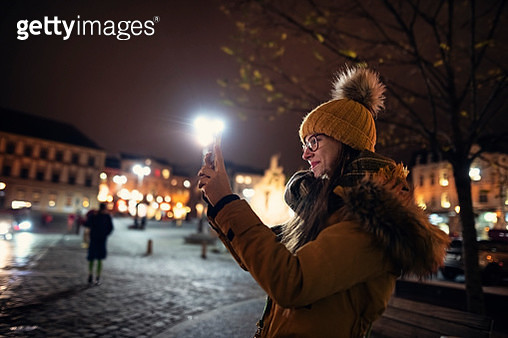 Teenage girl sightseeing city of Brno. The girl is taking photos in the Zelny Trh square. Nikon D850 - gettyimageskorea