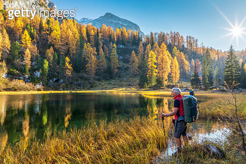 Lonely Hiker at Alpin Lake Schwarzensee in fall, Nationalpark Berchtesgaden - Alps - gettyimageskorea