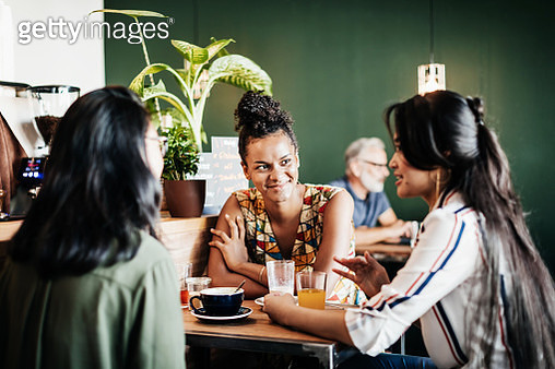 Small Group Of Friends Sitting In Cafe Drinking - gettyimageskorea